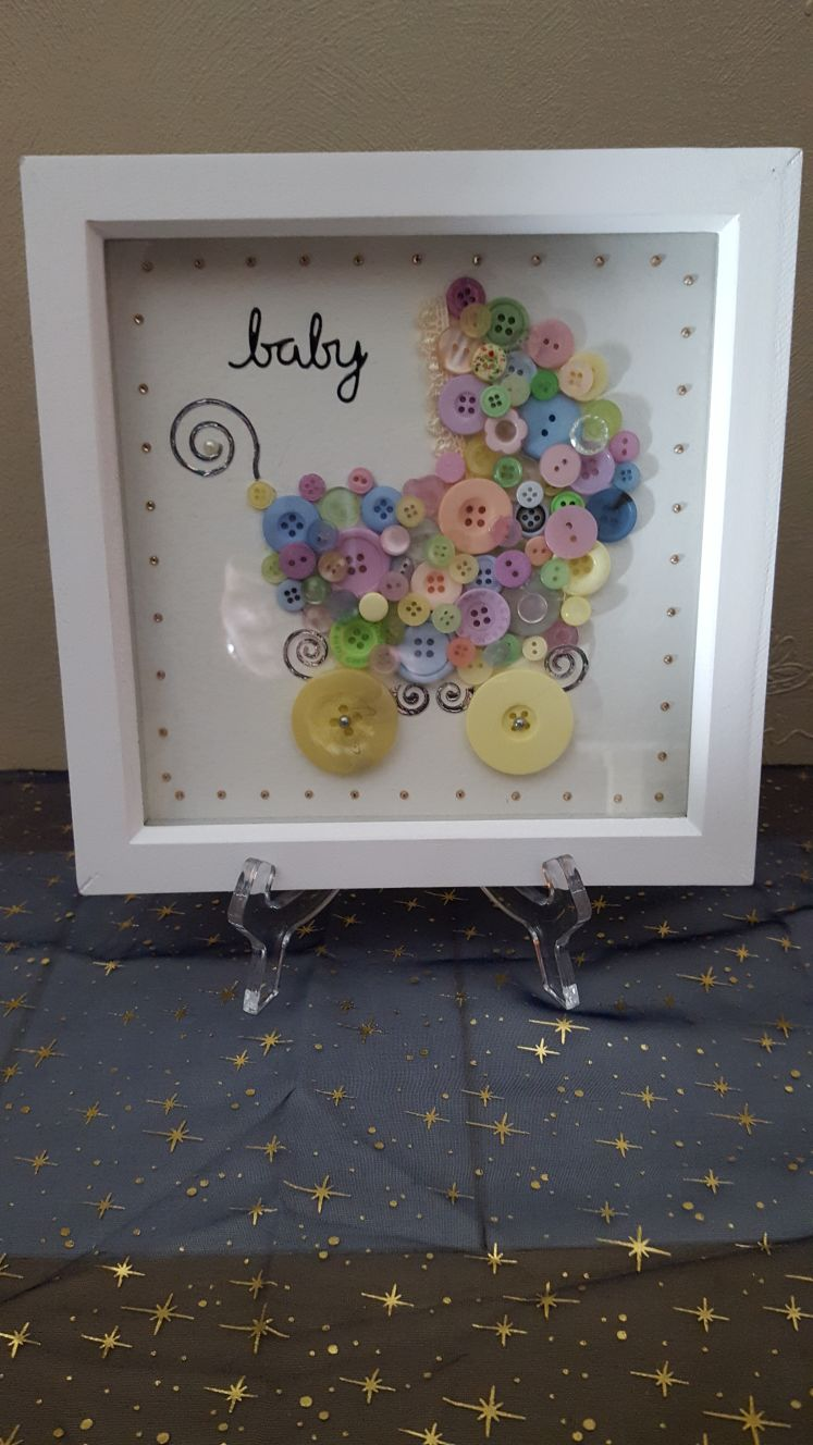 Baby pushchair picture made of buttons
