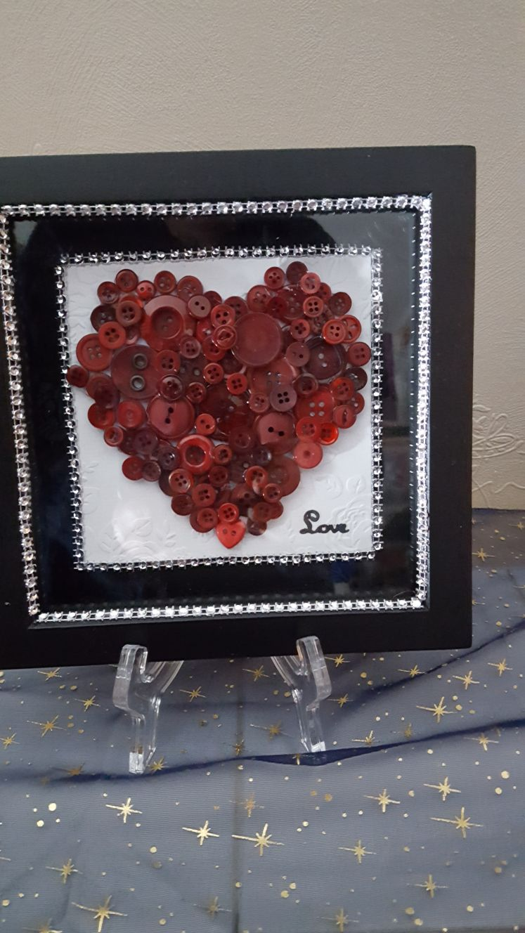 Red heart made of buttons
